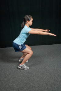 Squatting with knees in front of toes